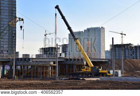 Mobile Telescopic Boom Crane On Bridge Construction. Truck Crane On Building Bridges. Road Work On T