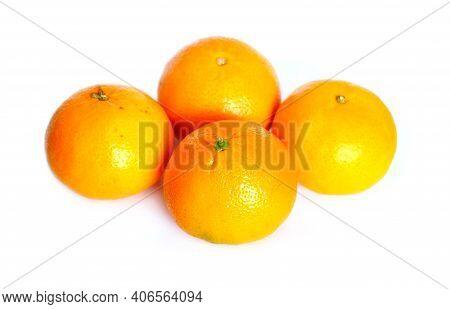 Still Life With Four Ripe Appetizing Oranges Isolated On White Background Studio Shot Closeup