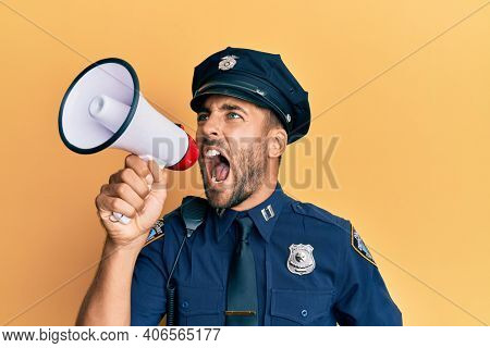 American police officer shouting through megaphone, yelling and protesting