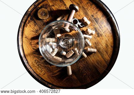 An Old Corkscrew Botle Opener And Corks On Top Of The Barrel And Wine Glass . Isolated.