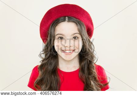A Smile On Her Lips. Smiling Kid With White Healthy Smile On Beautiful Face. Adorable Little Girl Wi