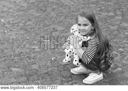 Youre My Friend. Small Girl Play With Toy Dog Outdoors. Little Child Enjoy Friendship. Childhood Fri