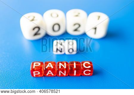 No Panic Is The Word Cubes, Blurred Date 2021 In The Background. A Year Without Panic