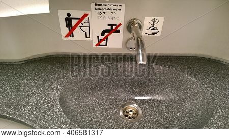 St. Petersburg, Russia - November, 2020: Modern Bathroom Sink And Faucet In Public Toilet And Restro