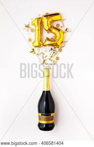 Happy 15th Anniversary Party. Champagne Bottle With Gold Number Balloon.