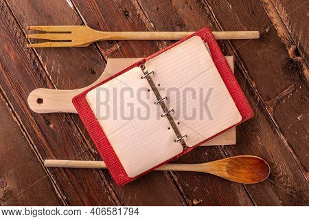 Vintage Empty Cookbook On Wooden Table With Cutting Board
