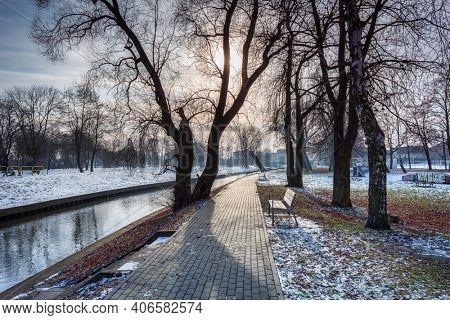 Pathway by the Radunia river in the winter park, Pruszcz Gdanski. Poland