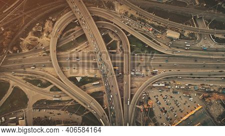 Aerial Top View City Highway Car Traffic System. Busy Road Junction Street Motion Overview. Business District Transport Development Travel Concept. Drone Flight Shot