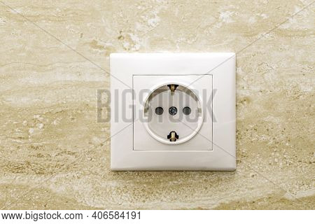 Electrical Socket On Brown Wall. European Electric Outlet.