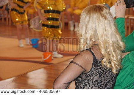Blonde With Beautiful Curly Hair. Woman With Silky Hair. Blonde Woman With Curly Beautiful Hair Rear
