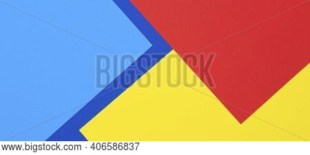 Creative Abstract Blue, Red And Yellow Color Geometric Paper Compositon Background, Top View