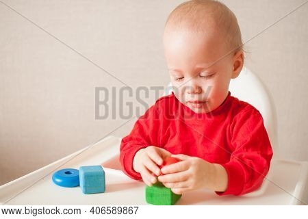 Little Girl Plays And Cries, All In Tears. High Quality Photo