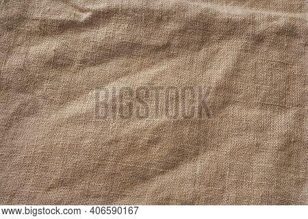 Cotton Burlap Cloth Fabric Background. Brown Hessian Jute Textile Napkin. Natural Organic Linen Tabl