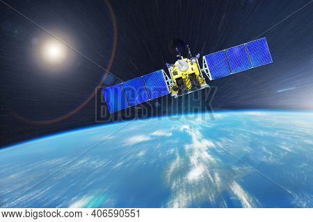 An Orbiting Communications Satellite And Other Researchers With Probes Rushes Into Earth's Orbit. El