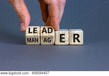 Manager Versus Leader Symbol. Businessman Flips Wooden Cubes And Changes The Word 'manager' To 'lead
