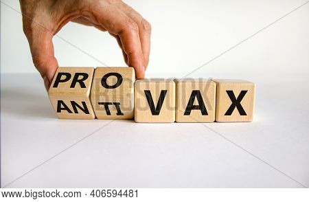 Pro-vax Or Anti-vax Symbol. Doctor Turns A Cube, Changes Words 'anti-vax' To 'pro-vax'. Beautiful Wh