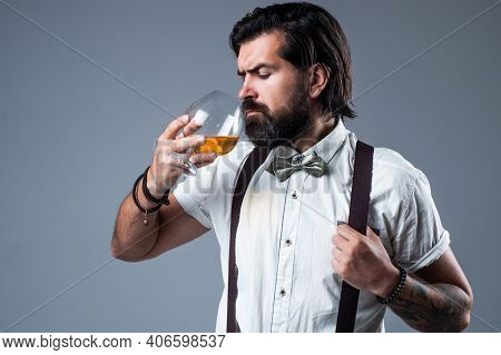 Alcohol Addict Concept. Brutal Handsome Man With Moustache. Mature Guy With Whiskey. Masculinity And
