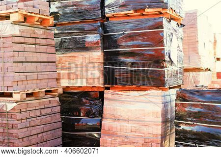 Pallets With Red Bricks Outdoors. Building Materials Wholesale. Pallets And Packages Of Freshly Prod