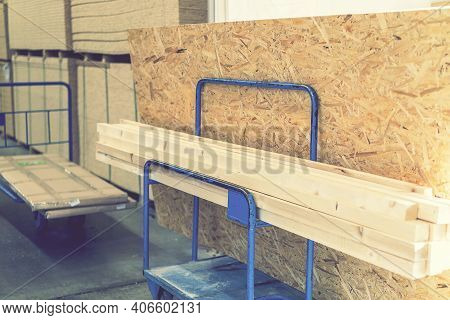 Trolley In A Hardware Store With Building Materials. Warehouse Large Storage. Trolley In A Hardware