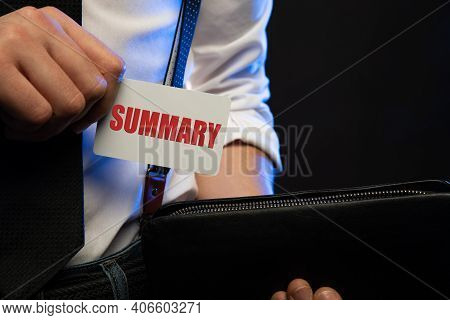 Hand Hold The Word Summary On Card With Black Background