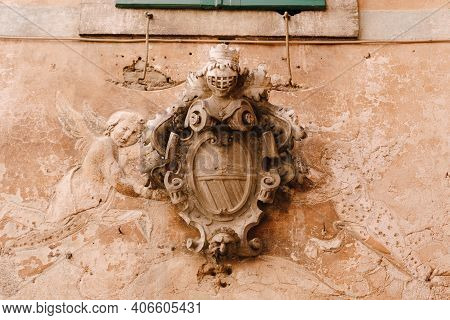 A Bas-relief On The Facade Of A Building In The Old Town Of Kotor In Montenegro. Knights Shield And