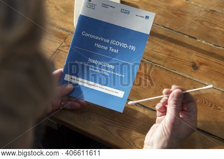 Oxford, Uk - February 2020: A Woman Reads The Government Covid-19 Home Test Kit