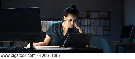 Late Night Workaholic Busy Business Woman At Computer