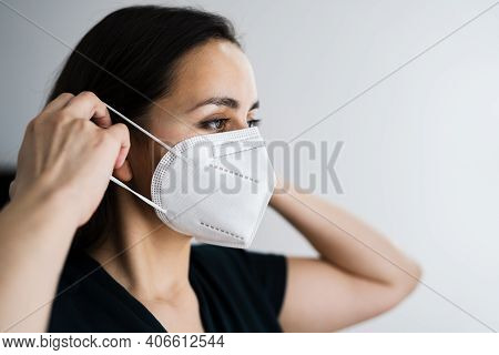 Woman Putting On Medical Ffp2 Face Mask