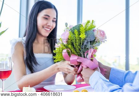Valentine's Day And Asian Young Happy Couple Concept, A Man Holding A Bouquet Roses Give To Woman Wi