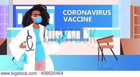 Female African American Doctor In Mask Standing In Hospital Corridor Coronavirus Vaccine Fight Again