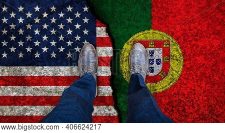 Business Man Stands On Cracked Flags Of Usa And Portugal. Political Concept