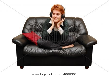 Red-Haired Girl Is Sitting On Sofa