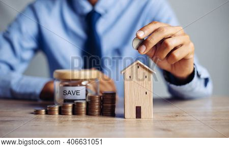 Business Hand Holding Home With Buy Or Rent, Copy Space. Property Investment And House Mortgage Fina