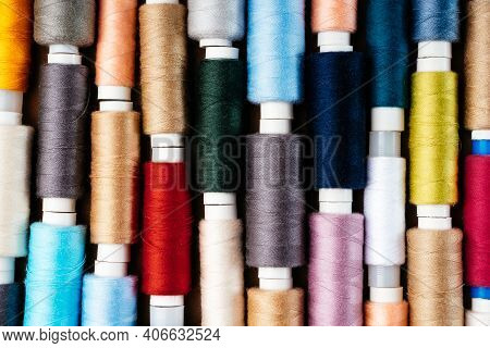 Many Different Reels With Threads, Flat Lay, Top View. Colored Threads, Close-up, Bright Background.