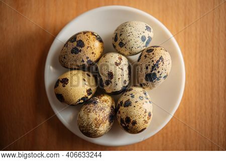Quail Eggs In A Plate Stand On The Table Surface Indoors. Food Ingredient.