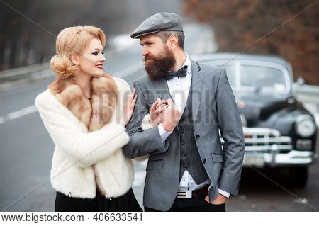 Couple Near A Retro Car Outdoors Walking. Vintage Style. Couple In Love And Relations