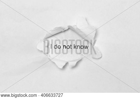 Word I Do Not Know On White Isolated Background, The Inscription Through The Wound Hole In Paper. Co