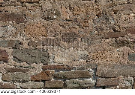 Stony Wall Of Medieval Castle Close Up, Authentic Stonework For Texture Or Background, Masonry Cobbl