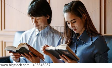 Close Up Woman Holding Read And Chant The Bible. A Man Standing With A Close Bible It Is The Belief