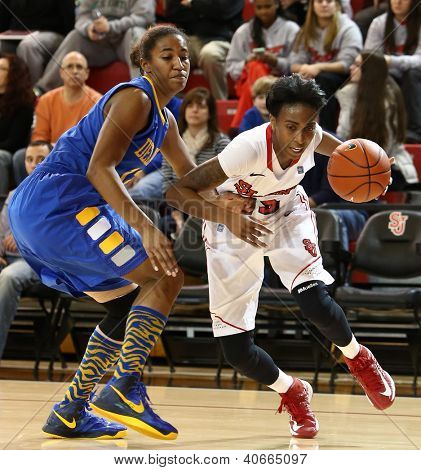 JAMAICA, NY-JAN 2: St. John's Red Storm guard Shenneika Smith (35) drives to the net against the Delaware Blue Hens at Carnesecca Arena on January 2, 2013 in Jamaica, Queens, New York.