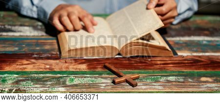 Close Up Hand. Asain Man Is Cross And Reading The Bible. According To Beliefs And Beliefs In Christi