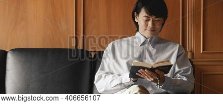 Asian Man The Faithful And Christian Holding Cross Is Reading The Bible To Pray To Jesus In The Cruc