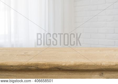 Tabletop On Blurred Curtained Window And White Brick Wall Background
