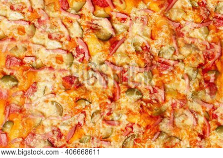 Surface Of Baked Homemade Pizza Close-up With Salami, Sausage, Cheese, Herbs. Background, Wallpaper