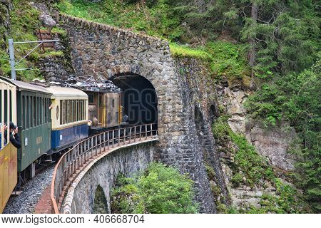 Nostalgic Train Ride In The Swiss Mountains Into A Tunnel On The Railway Line Davos - Filisur. Locom