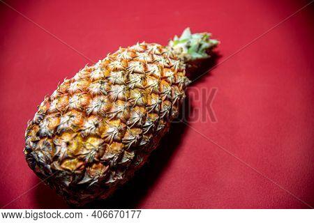 Fresh Pineapple Fruit On Red Background