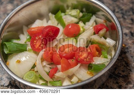 Natural Vegetable Salad Served In A Metal Casserole Dish