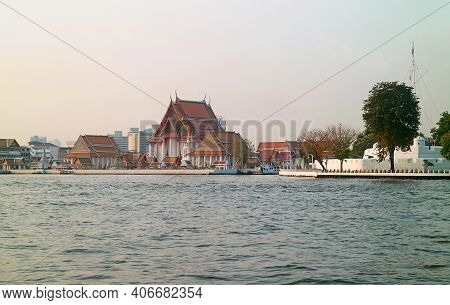 Wat Kalayanamitr Buddhist Temple And The White Ramparts Of Vichai Prasit Fort On Chao Phraya River B