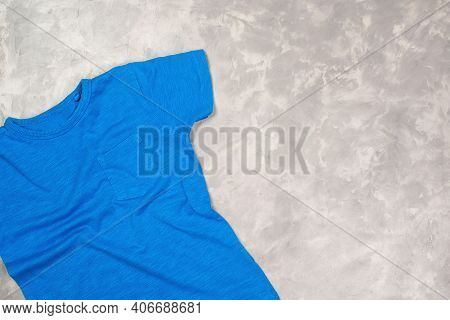 Blue Paint T-shirt With Copy Space. T-shirt Mockup, Flat Lay.