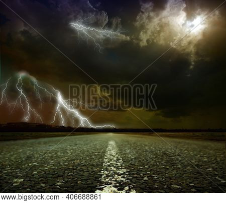 Summer Country Road With Lightning. Rural Environment Road. Nature Road. Asphalt Road. Landscape Wit